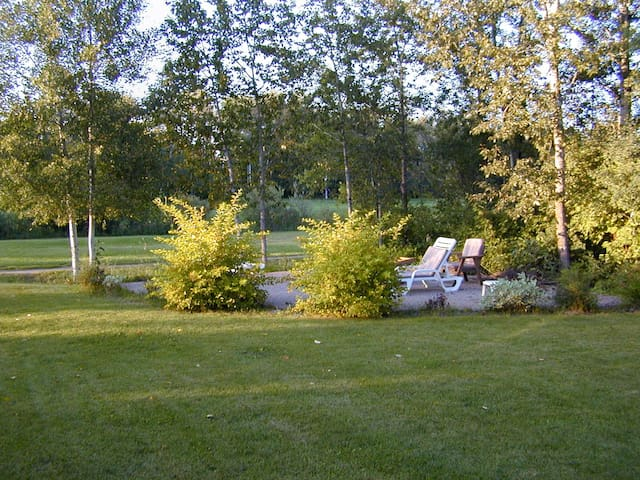 Fire pit area in back yard. Backs onto golf course