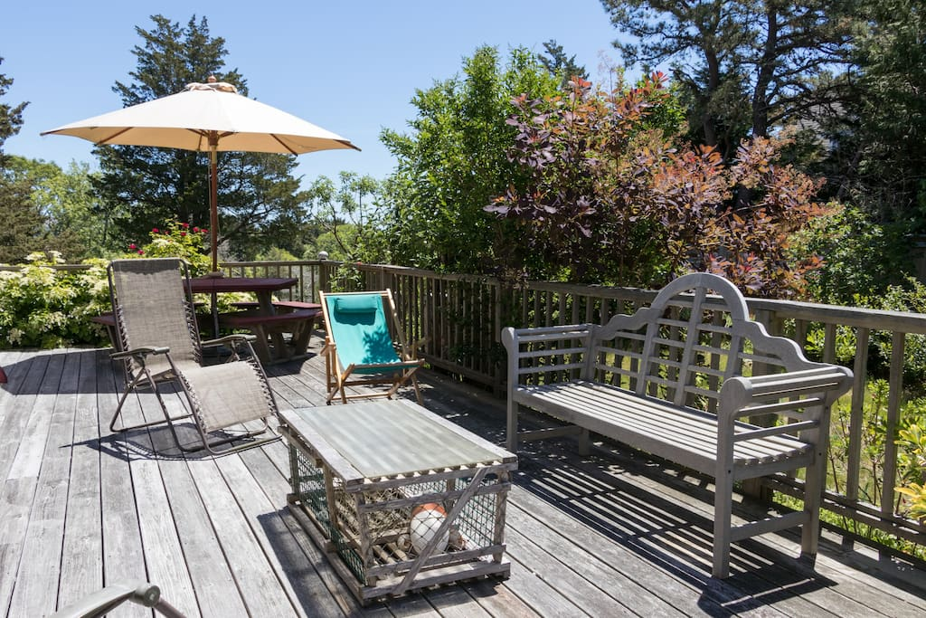 A large deck with seating overlooks the gardens