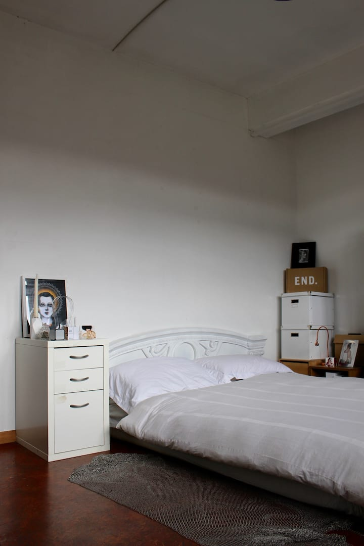Relaxed Bedroom in Converted Warehouse in Dalston