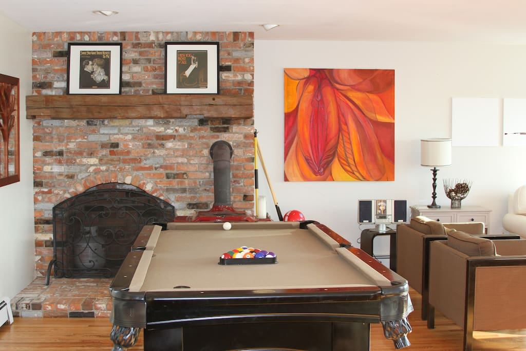 Pool table and wood burning stove.