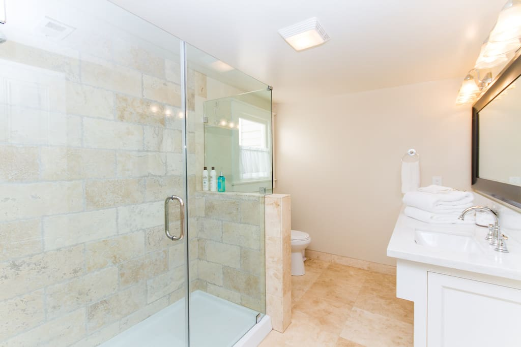 Private bathroom features an extra large shower and dual sinks.