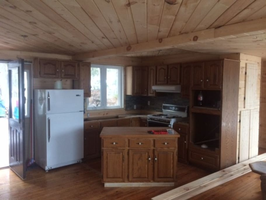 Fully functional kitchen with all necessary appliances, pots, pans, dishes etc.