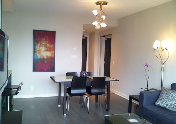 Dining area and entry hallway as seen from balcony door. Walnut flooring.