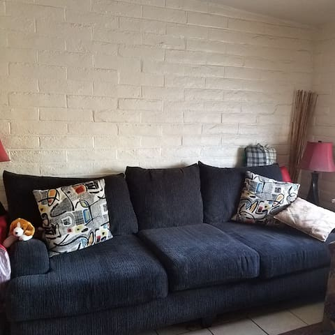 Cozy, comfortable and clean couch in the living room. Bedding provided.