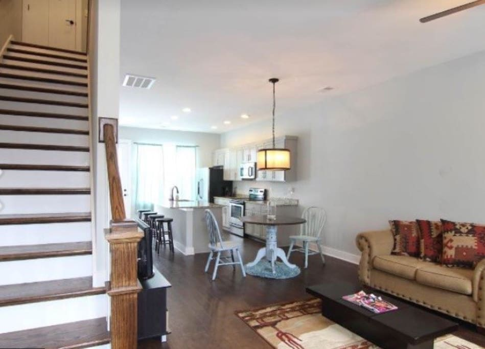 Top Floor has two bedroom with 2 King Size Beds that are super Comfy! Downstairs has a kitchen table plus 4 stools and two couches!