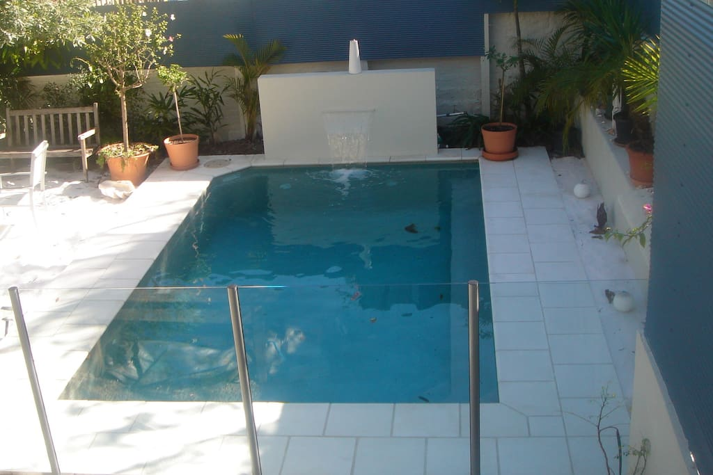 Sparkling pool, silky white sand beach in a private tropical setting.