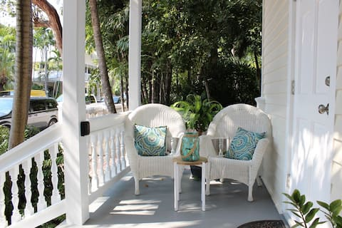 Front porch for relaxing and people watching.