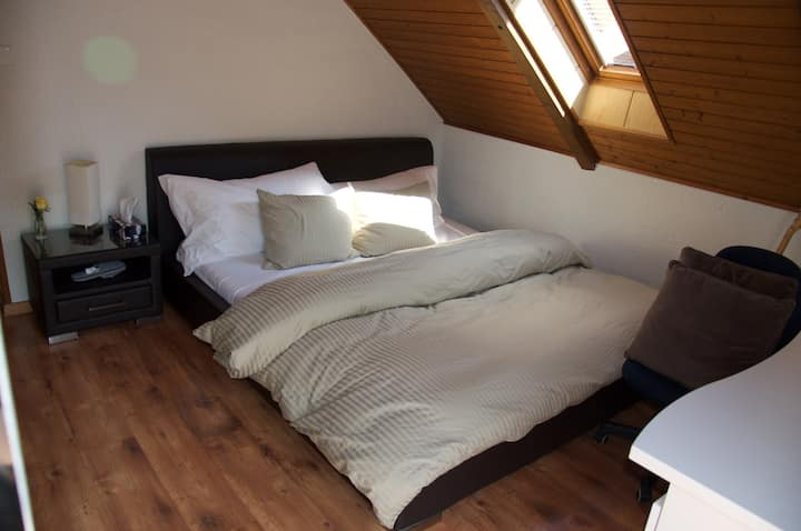 your cozy bedroom in the very heart of Switzerland