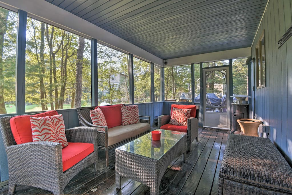 Retreat to the screened-in porch with 2 armchairs and a love seat!