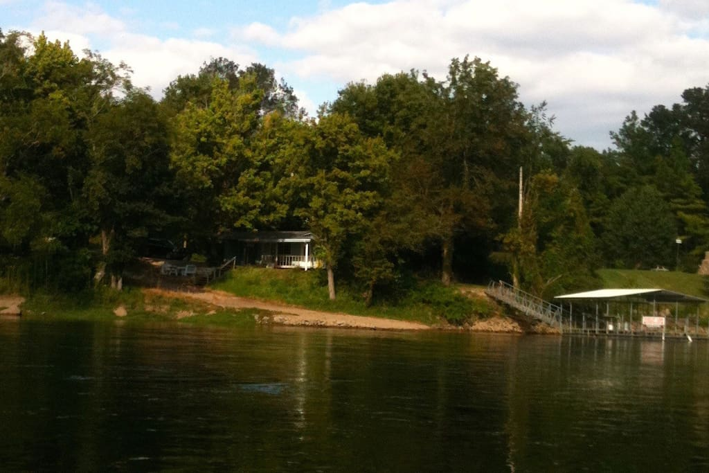 Rivercliff cabin and private dock on white river.