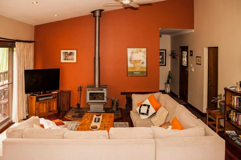 Luxurious 8 Person Lounge with Fire Place, Flat Screen TV and Hight Catheral Style Ceiling