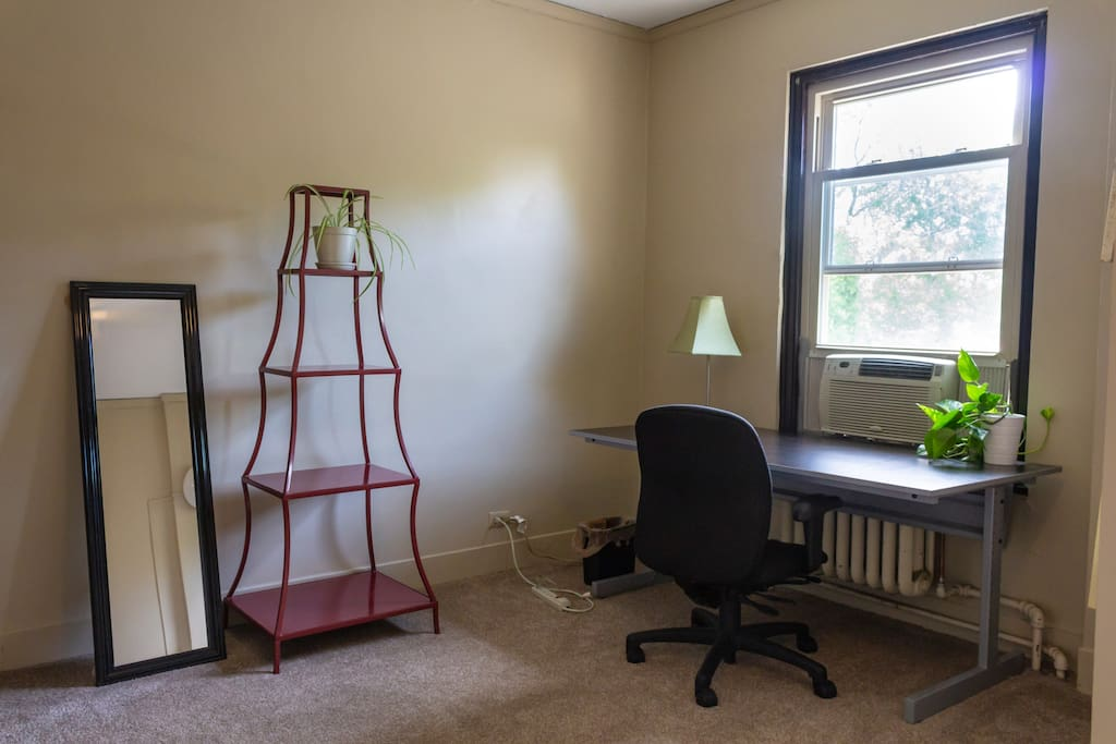 The room features a full-sized closet, a desk, and air conditioning.