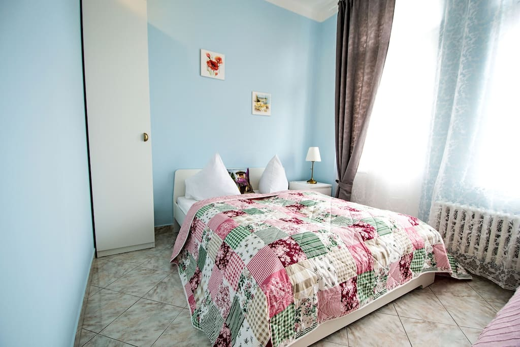 1st bright bedroom with comfy double bed and a single bed and entrance to the balcony!