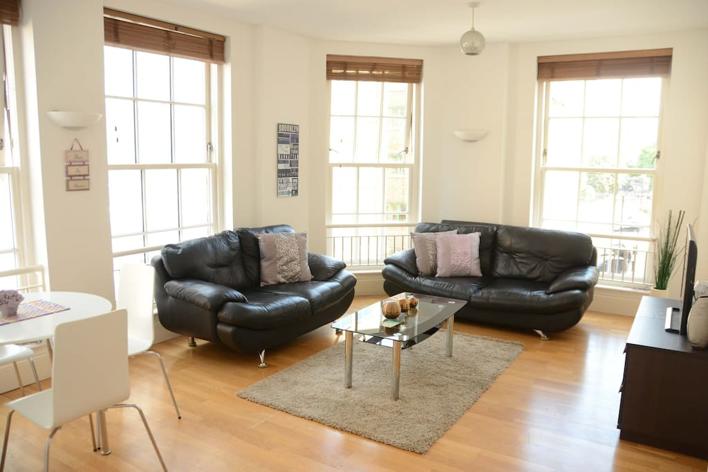 Bright airy living room, with Panasonic flat screen smart tv and in built media player