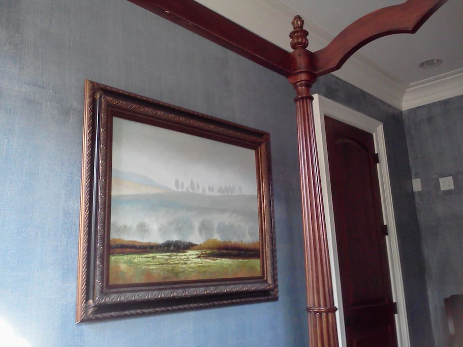 """Beautiful paintings are throughout the house.  The blue bedroom has """" foggy meadow"""".  A view from the bed lying down."""