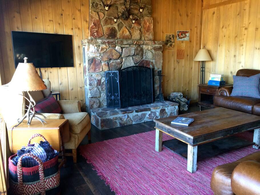 Living Room with wood burning fireplace & Flatscreen TV.