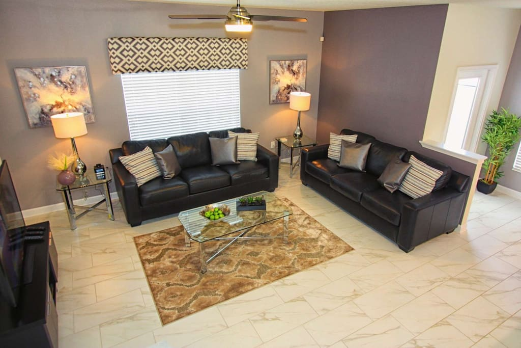 Titled Flooring and Modern Furniture Grace the Main Living Area