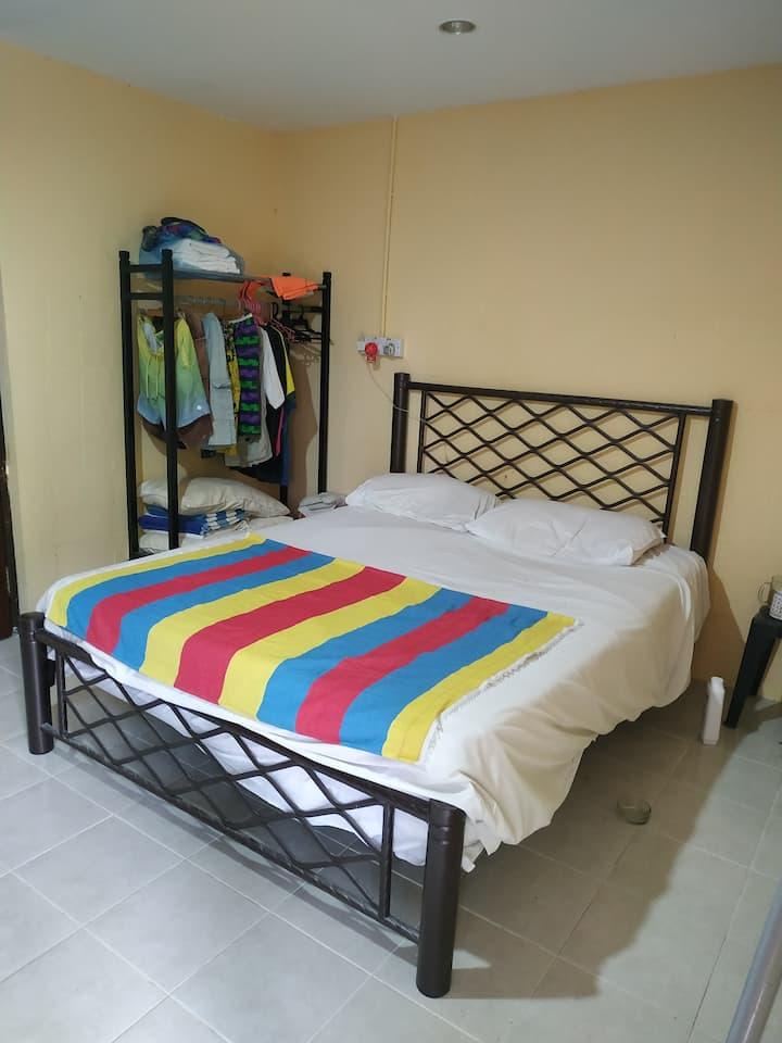 Cozy Kampong house 5 min to beach on foot.
