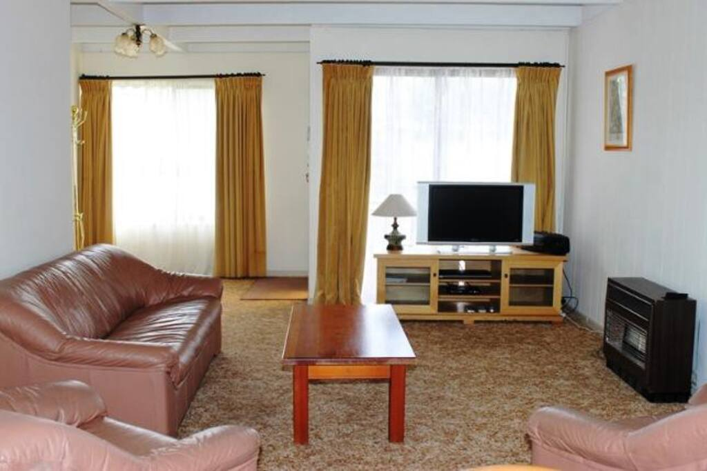Spacious lounge room with DVD and TV