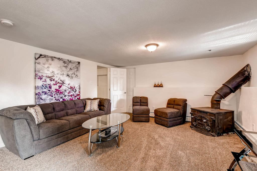 Primary living room, Brand new, never-used furniture throughout. Wood stove is decorative only - not operable.