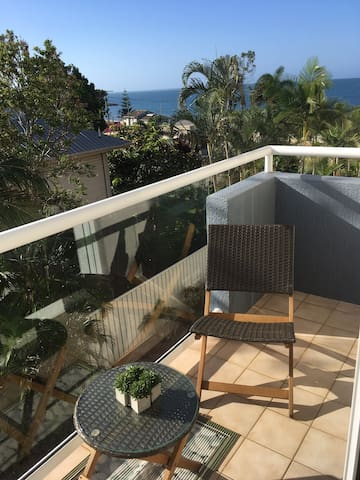 Private balcony off bedroom. Umbrella available if too sunny.