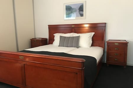 King size bed with 2 single duvets