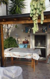 Bilocale con giardino privato