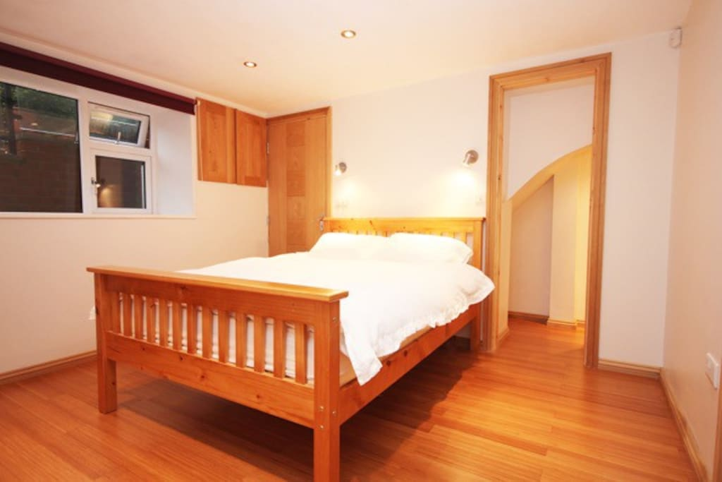 Double bed in the bedroom- little walk in wardrobe on the right
