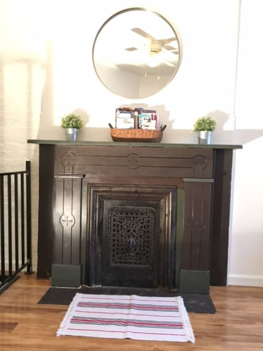 Fireplace with guidebooks/maps in the basket
