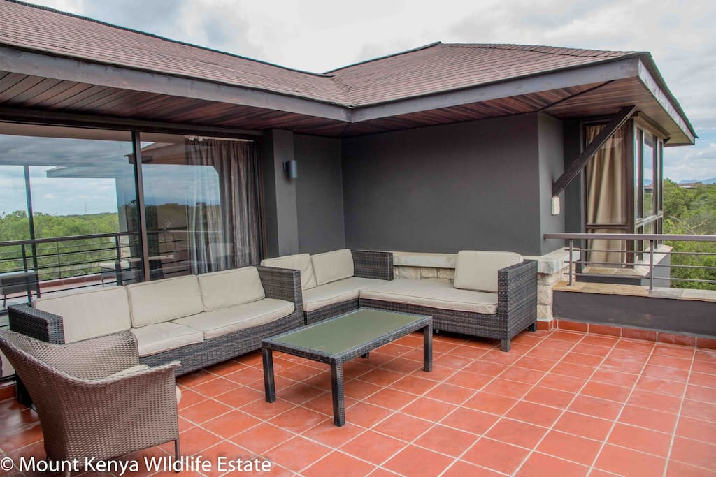 Terrace upstairs with wonderful views of Mount Kenya and a water hole