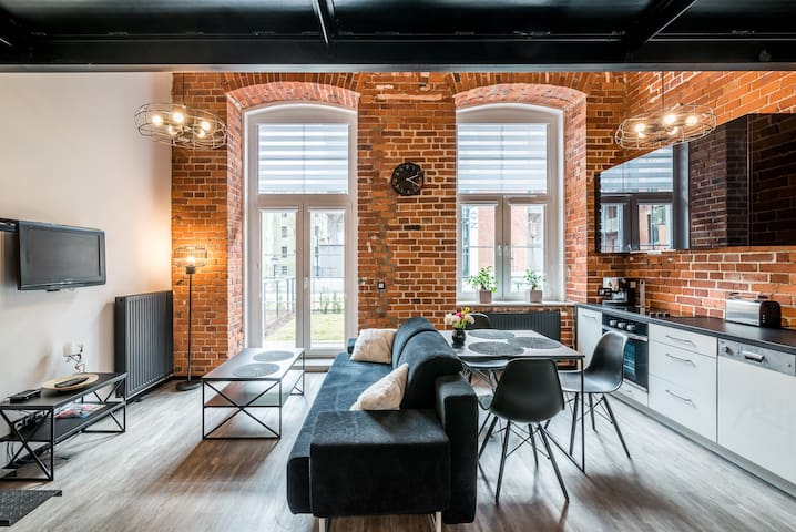 Industrial Apartment with Entresole and Garden