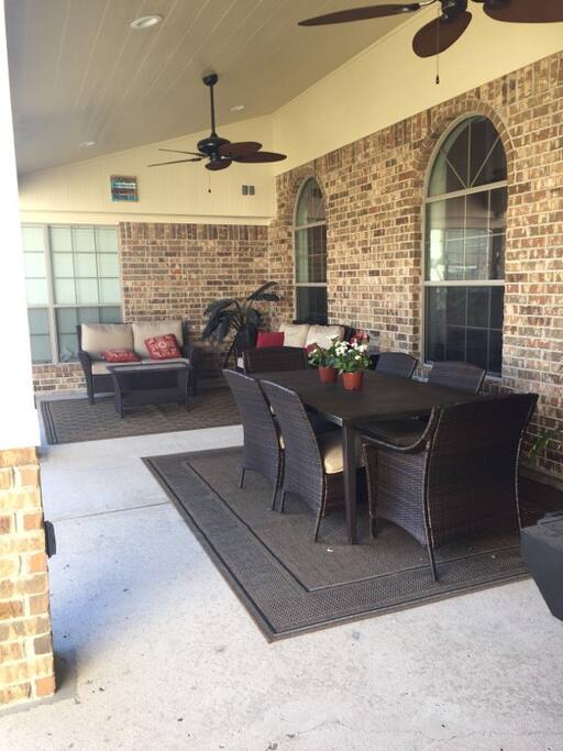 OUTDOOR PATIO W/ GRILL, HEATER, SMALL FRIDGE, ICE CHESTS, DINING, SEATING
