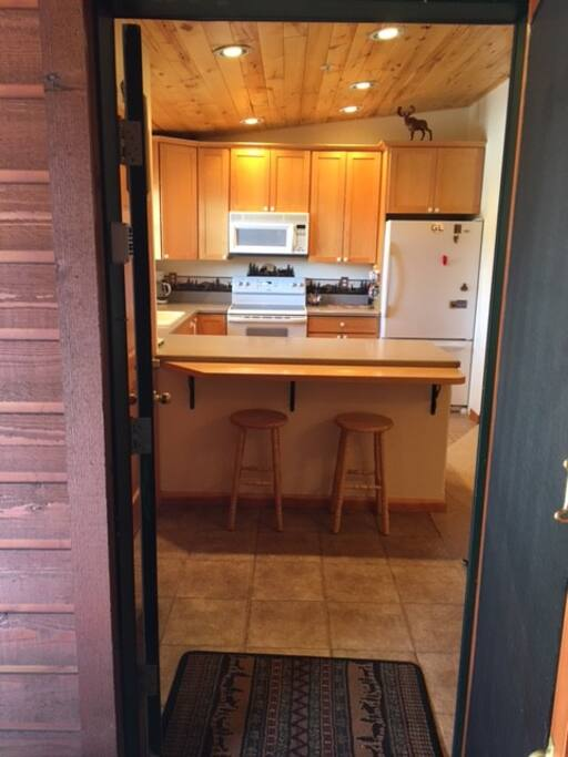 Open entry with large storage/coat closet on left