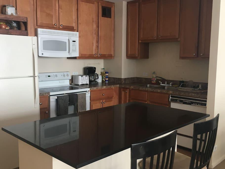 Large kitchen with huge granite island