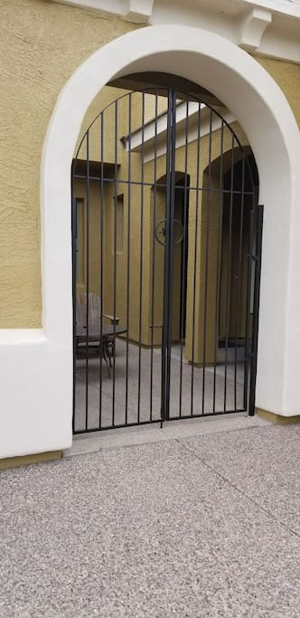 Pull up.latch gate access leading to courtyard and casita entrance