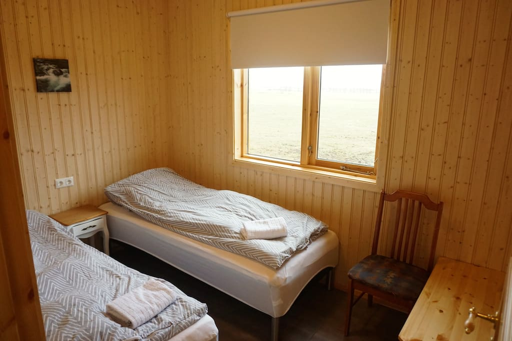 Bedroom 1, two single beds.