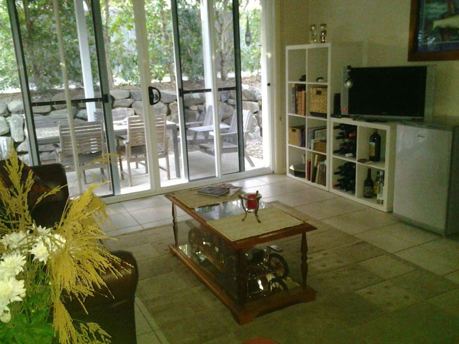 Guests only lounge with tv video and outdoor living area on ground level.