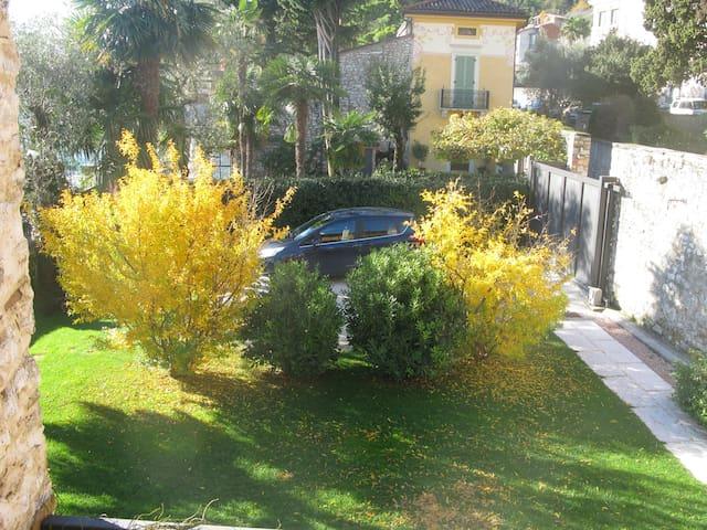 Two parking spots inside the garden
