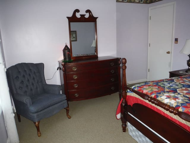 B&B-2 Mahogany BR has spacious Dresser and wingback chair.