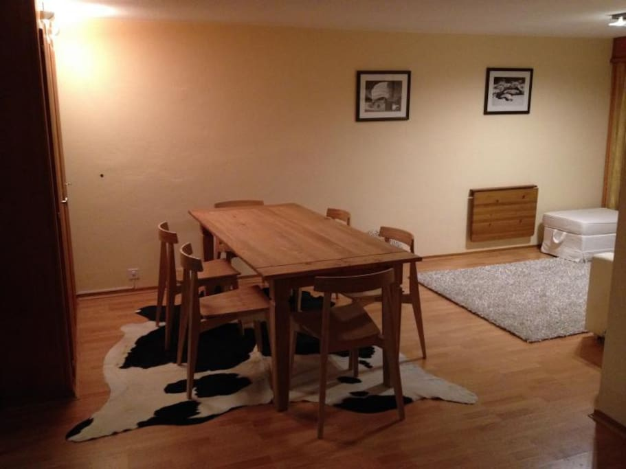 Comfortable dining room with large table and a nice sitting area
