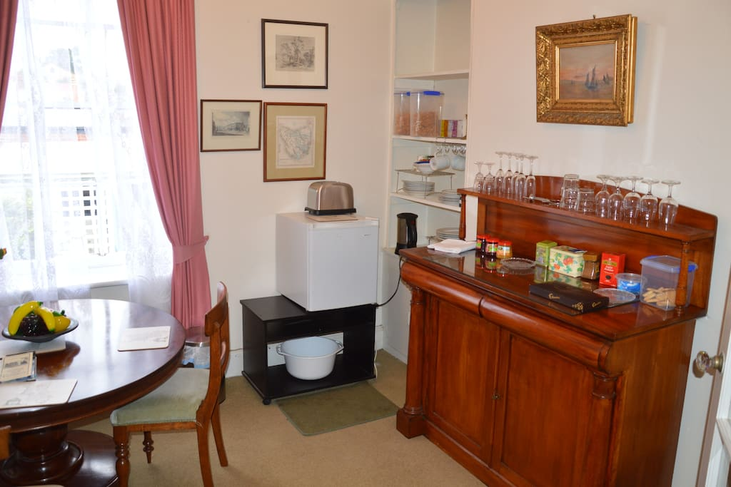 Breakfast area contains a bar fridge, electric kettle, microwave and toaster.