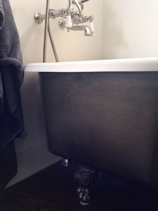 Master Bath includes Claw Foot Tub, Walk in Shower and Dual Marble Vanity.