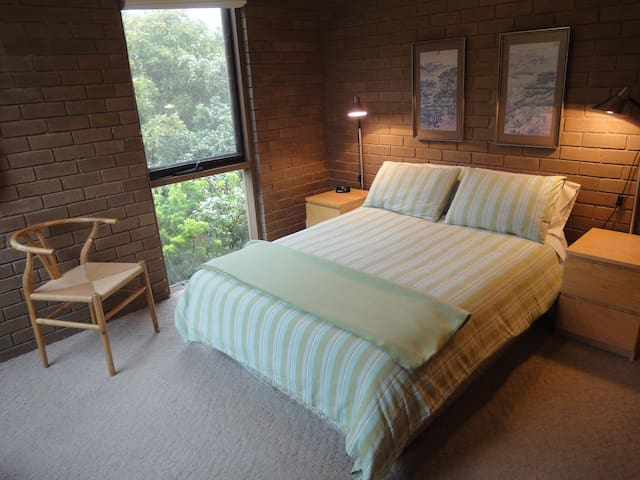 MASTER BEDROOM. The Master Bedroom with double bed has a built in wardrobe and windows that open to the relaxing sounds of the nearby breaking surf.
