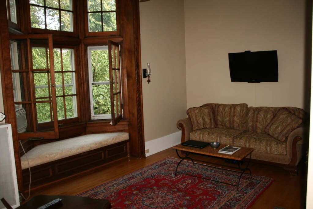 Living Room with gorgeous 10 foot bay window seat overlooking yard.