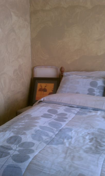 Lovely art work on both sides of the bed