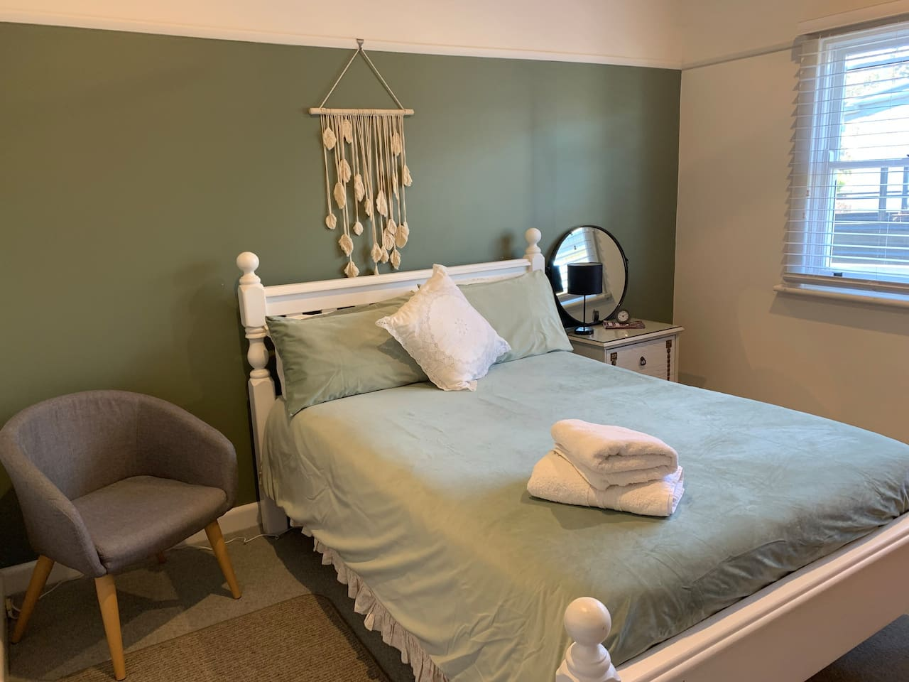 Cosy, clean and inviting guest room one.