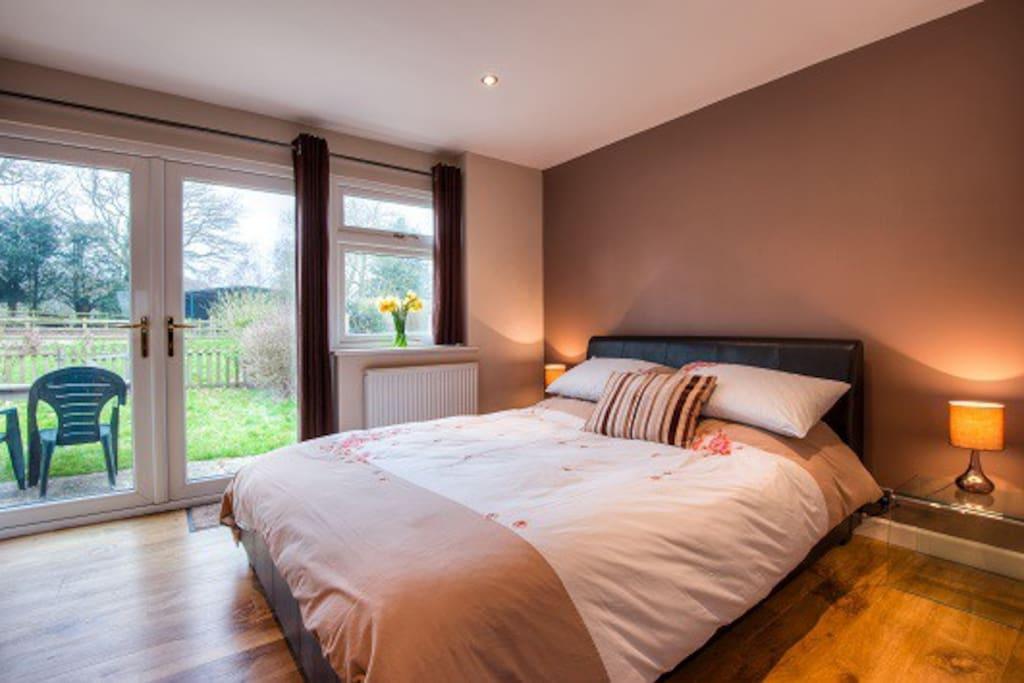 Big comfortable memory foam mattress. Doors to private garden.