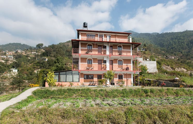 Laxmi's Bed and Breakfast is located close to the city but without the noise and pollution; nestled in the rolling green foothills overlooking Kathmandu in a residential neighborhood that has retained its village ambiance.