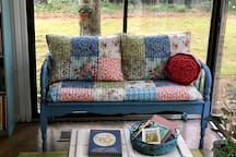 The sunroom has several areas to sit and enjoy the big backyard.