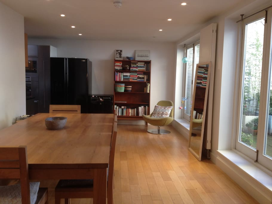 Dining room.  Two sets of folding doors to private garden.  8 seater dining table.